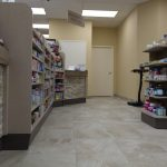 Pharmacy interior, displaying their shelves stocked with various medications