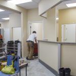 Man pushing trolley during pharmacy renovation